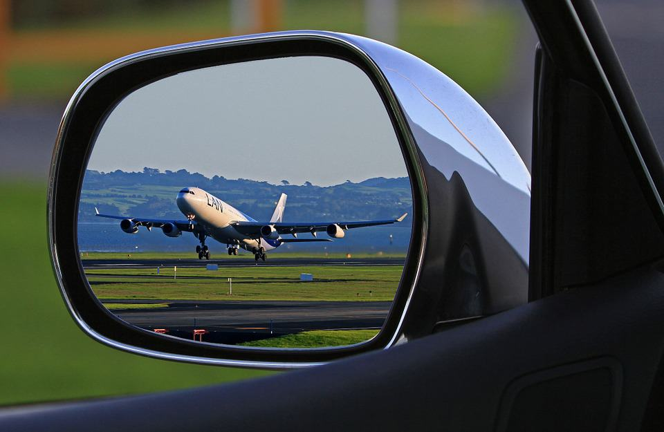Plane in side view mirror
